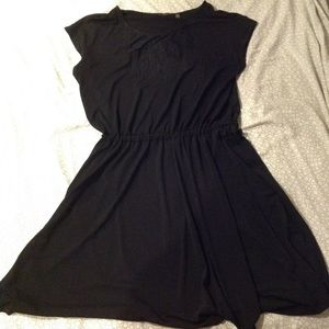 Black knee length dress with lace detail in front